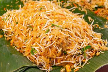 Closeup cooking Pad Thai noodles, Thai street food in the market popular Thai Food Bangkok Thailand