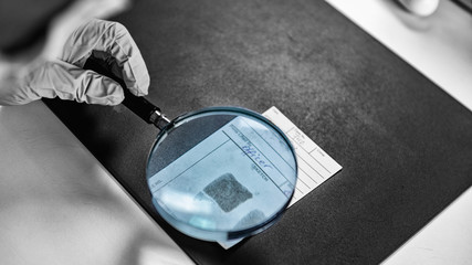 Forensic Science Technician Analyzing Evidence in Laboratory