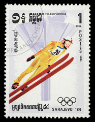Stamp printed in Cambodia shows image of ski jumper on occasion of the Olympic games in Sarajevo circa 1984.
