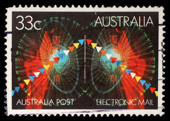 Stamp printed in Australia shows symbols of electronic mail, circa 1985