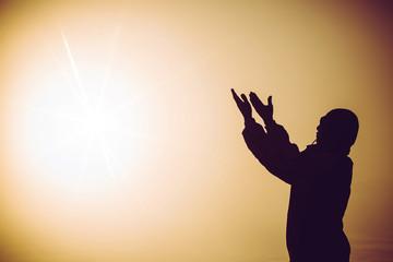 Faith of christian concept: Spiritual prayer hands over sun shine with blurred beautiful sunrise background