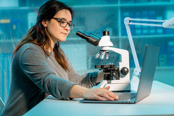 Female scientist researcher conducting an experiment in a laboratory