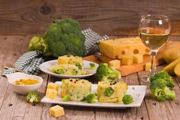 Potato gratins with broccoli florets.