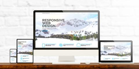 responsive web design website devices on wooden desktop