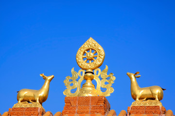 Gold and copper ornaments on the roof in a temple
