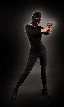 Girl in Black with Gun