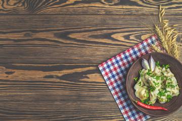 Traditional italian ravioli with fresh parsley on plate