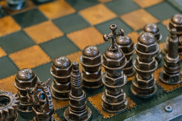Chess pieces set on chess board. Strategy board game. Toned image with space for text and selective focus on black queen. Abstract background.
