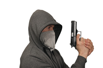 The man keeps a gun about the head in a mask. White background