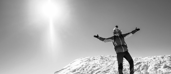 Beautiful young woman in winter mountains, Smiling woman on snowy mountain top, Black and White photo with woman in snowy mountains panorama symbol