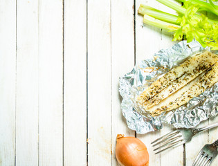 Fototapete - Baked fish fillet with spices and celery.