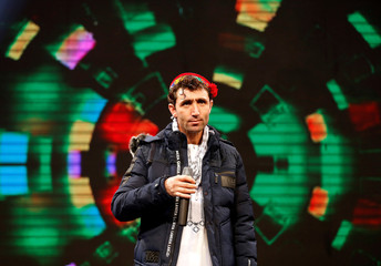 "Abdul Salam Maftoon performs during rehearsals in the ""Afghan Star"" talent show at Tolo TV studio in Kabul"