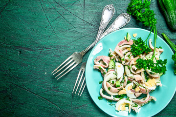 Salad of squid, cucumber and greens.
