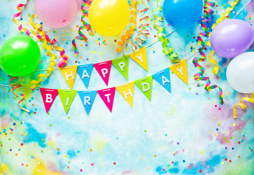 Birthday party frame with balloons, streamers and confetti on colorful background with copy space