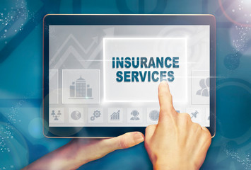 A hand selecting a Insurance Services business concept on a computer tablet screen with a colorful background.