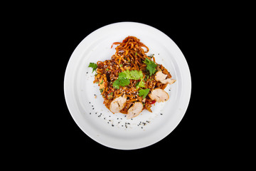 noodles with meat on a black background