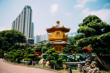 China, Hong Kong, Diamond Hill, Nan Lian Garden, Golden Pavilion of Absolute Perfection surrounded by skyscrapers