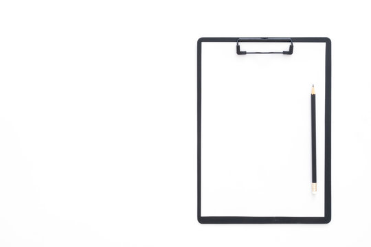 Creative flat lay photo of workspace desk. Top view office desk with pencil and blank clipboard on white color background. Top view with copy space, flat lay photography.