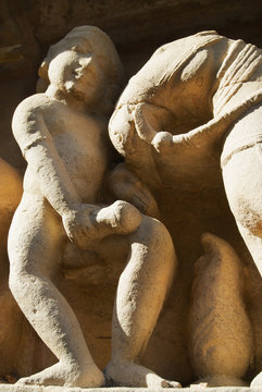 Erotic sculptures at Vishvanatha Temple at the  Western temples of Khajuraho in Madhya Pradesh, India. UNESCO World heritage site.