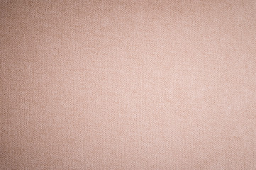 Textured background surface of textile upholstery furniture close-up. burlap beige color fabric...