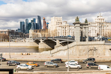 Russia, Moscow, Bridge in the city over Moskva river with financial district in background