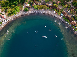 Indonesia, Bali, Amed, Aerial view of Jemeluk beach with banca boats