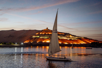 Sunset in Aswan Egypt with Felucca boat on the Nile river