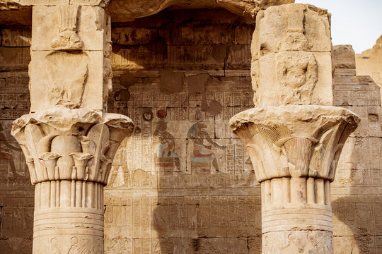 Ancient hieroglyphics still visible in colour on the exterior of Edfu Temple near Luxor Egypt