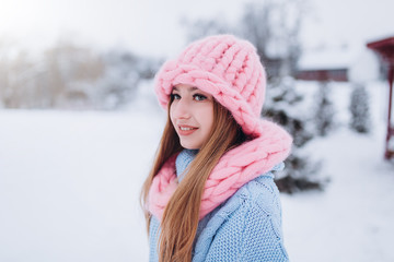 Close up winter portrait of young positive happy freedom hipster caucasian pretty fashionable girl outdoors in winter park smiling and having fun