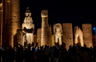 Tourist visiting the Temple of Luxor at night in Luxor, Thebes, Egypt