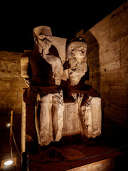 Statue of King Tutankamen and his Queen at the Luxor Temple in Egypt at night