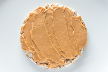 Rice cereal cracker with peanut paste butter.