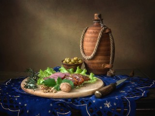 Still life with olives and smoked meat
