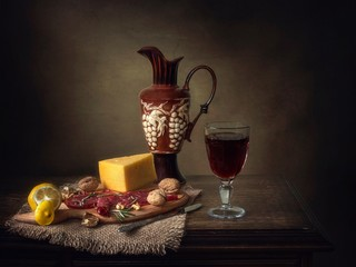 Still life with cheese and smoked meat