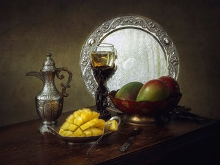 Still life with mango and wine glass