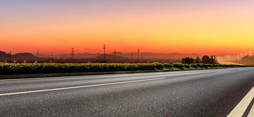 Empty asphalt road and hills at beautiful sunset,panoramic view Fotomurales
