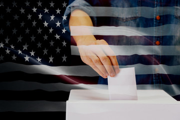 Close-up of man casting and inserting a vote and choosing and making a decision what he wants in polling box with United States flag blended in background.