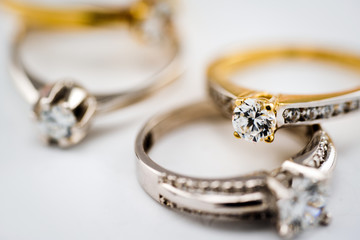 Engagement diamond wedding ring group on white background, diamond, golden rings