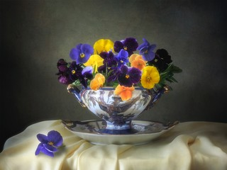 Still life with bouquet of  viola flowers