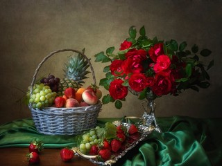 Still life with bouquet of red roses and fruits