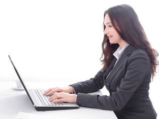 side view.business woman typing on a laptop.