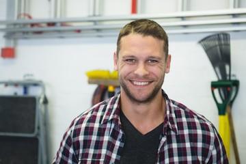Male carpenter smiling in workshop