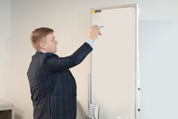 close up.businessman writes a marker on the Board