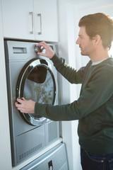 Man operating washing machine