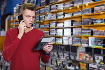 man speaking by phone during shopping
