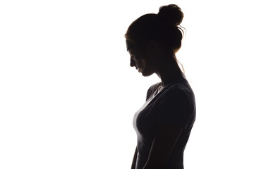 profile silhouette of a pensive girl, a young woman lowered her head down on a white isolated background