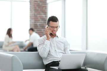 businessman working sitting in the lobby of a modern office