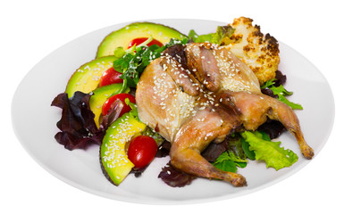Image of quail-tobacco with sesame which served with salad of avocado and greenery