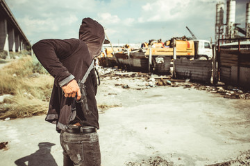 Gangster getting gun out his pants before attacking truck stop