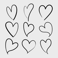 Vector set of doodle hand drawn isolated hearts icons. Design elements